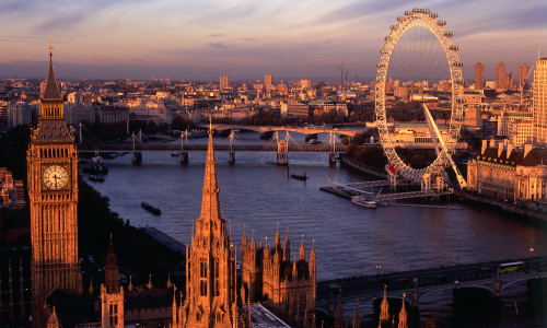 View from the top of the Victoria Tower, the lesser known of the two towers of the Houses of Parliament, towards Big Ben, the River Thames and the London Eye
